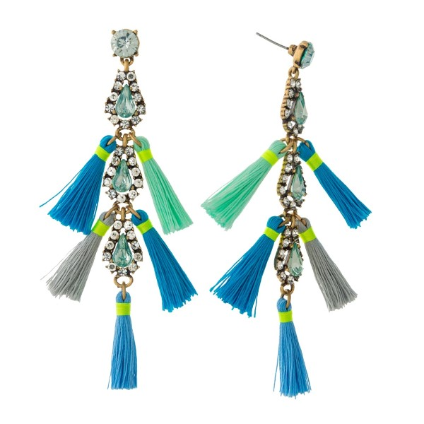 "Gold tone statement earrings with clear and mint green rhinestones and blue, gray and mint green tassels. Approximately 4"" in length."