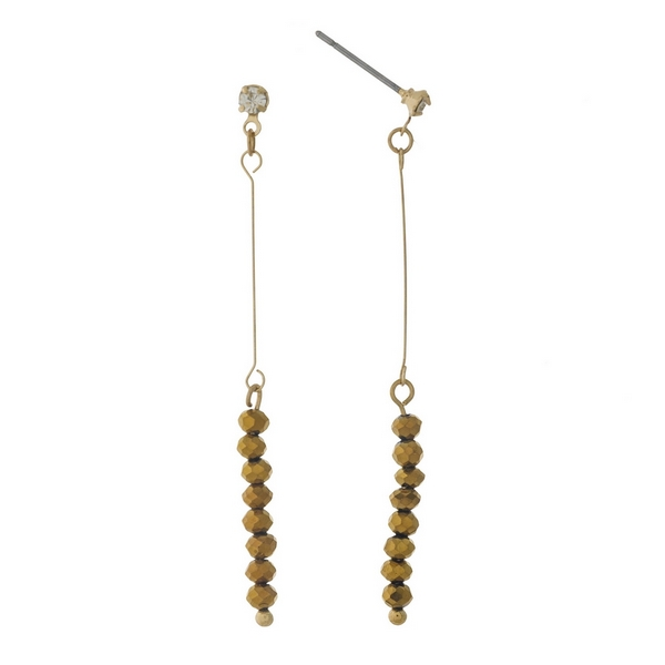 "Dainty gold tone stud earrings featuring bronze faceted beads. Approximately 2"" in length."