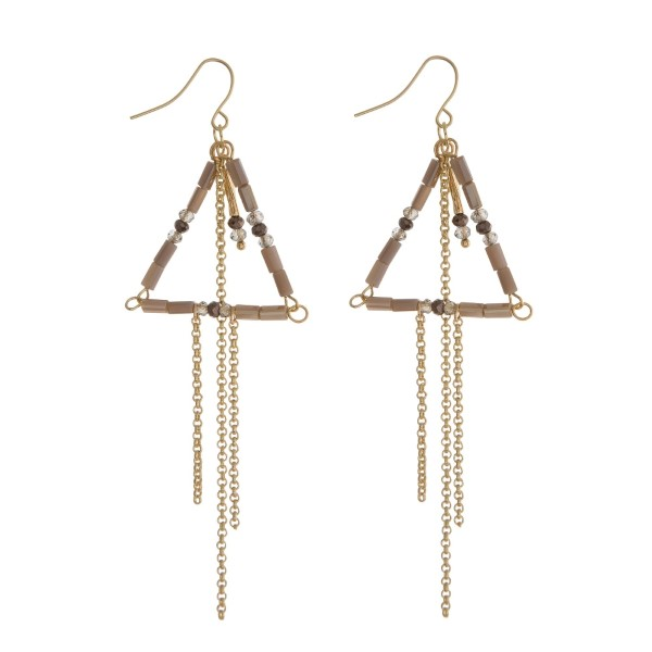 "Gold tone fishhook earrings with a gray beaded triangle and chain fringe. Approximately 3"" in length."