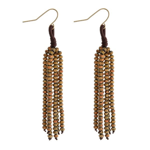 "Gold tone fishhook earrings with a bronze beaded tassel. Approximately 2.5"" in length."