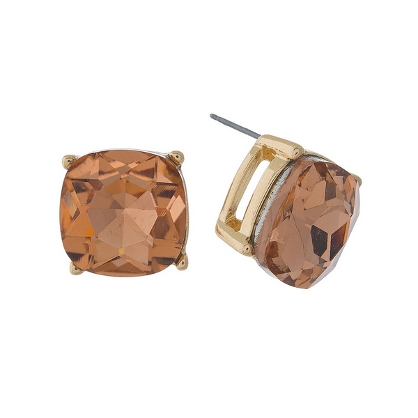 "Gold tone stud earrings with a peach rhinestone. Approximately 1/2"" in length."
