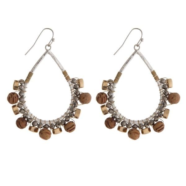 "Silver tone fishhook earrings with a picture jasper wrapped teardrop shape. Approximately 2"" in length."