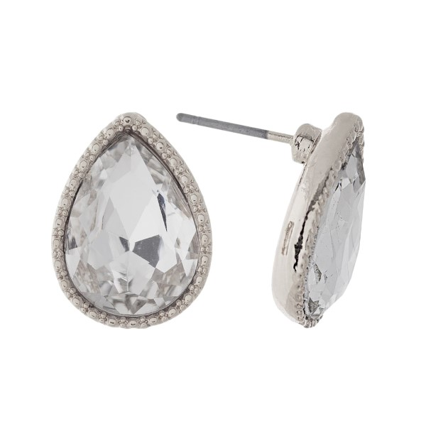"Silver tone teardrop stud earrings with a clear rhinestone. Approximately 1/2"" in length."