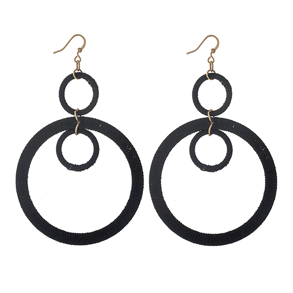 """Gold tone fishhook earrings with three black thread wrapped circles. Approximately 2.5"""" in length."""
