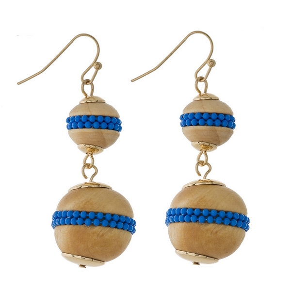 "Gold tone fishhook earrings with two wooden beads and blue bead accents. Approximately 2"" in length."