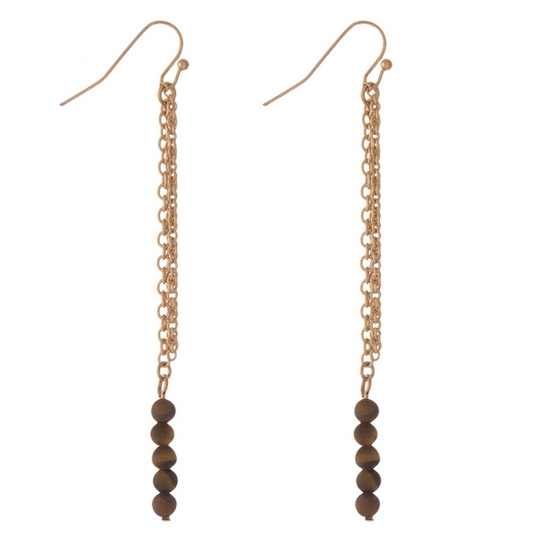 """Gold tone fishhook earrings with tiger's eye natural stone beads and chain fringe. Approximately 3.5"""" in length."""