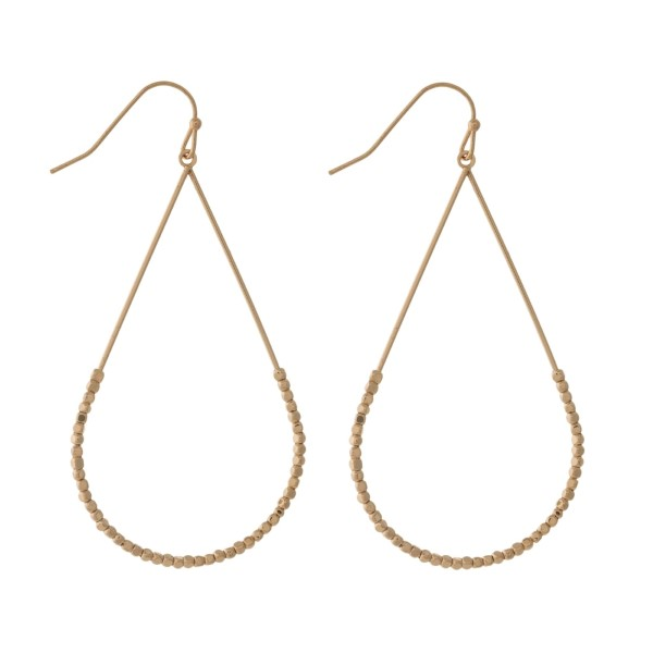 """Dainty fishhook earrings with an open teardrop shape and beaded accents. Approximately 2.25"""" in length."""