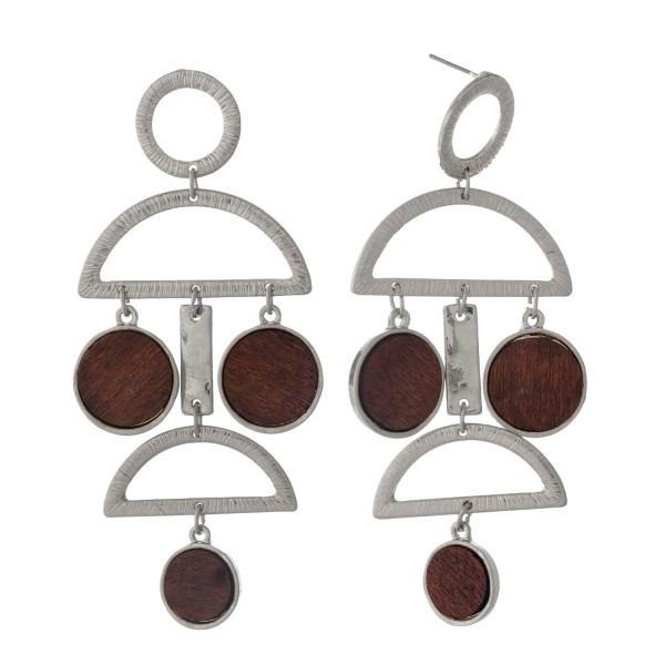 "Silver tone post style earrings with open geometric shapes and wooden circles. Approximately 3"" in length."