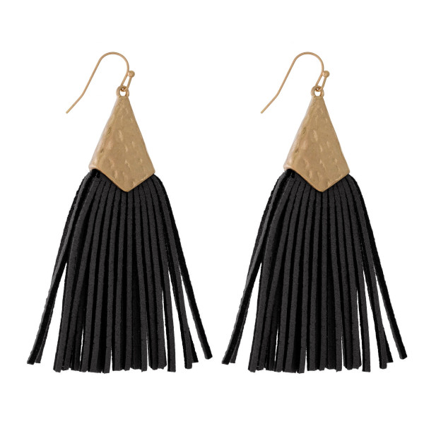 "Gold tone fishhook earrings with a hammered gold tone shape and faux leather tassel. Approximately 3.5"" in length."