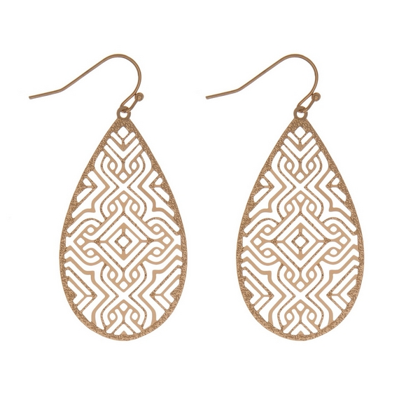 "Dainty gold tone fishhook earrings with a laser cut design on a teardrop shape. Approximately 2"" in length."