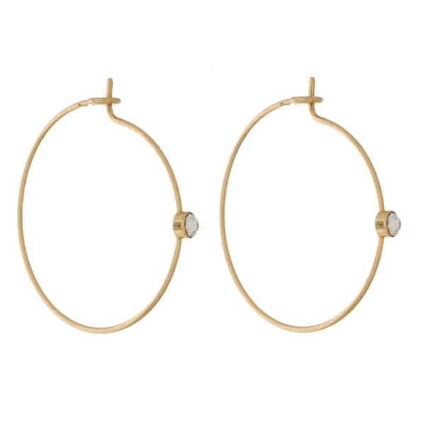 "Dainty full circle, hoop earrings with a rhinestone accent. Approximately 1"" in diameter."