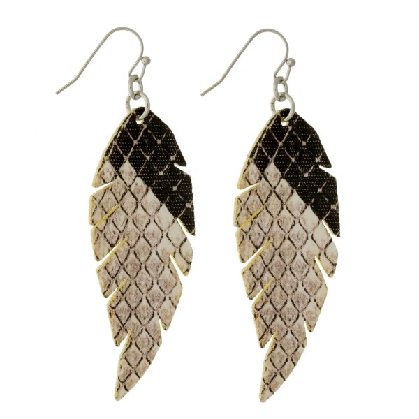 "Faux leather, fishhook earrings with a feather shape and a snakeskin pattern. Approximately 2.25"" in length."