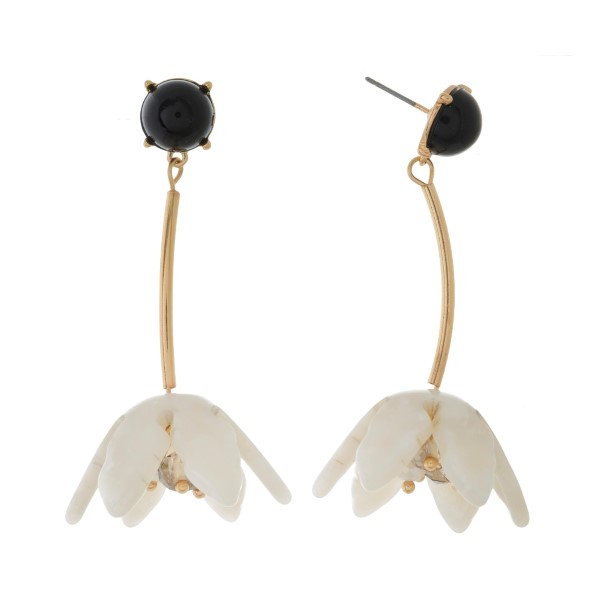"""Gold tone post earrings with an acetate flower and beaded accents. Approximately 2"""" in length."""