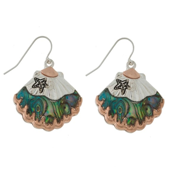 "Silver tone fishhook earrings with a two tone seashell and abalone accents. Approximately 1"" in size."