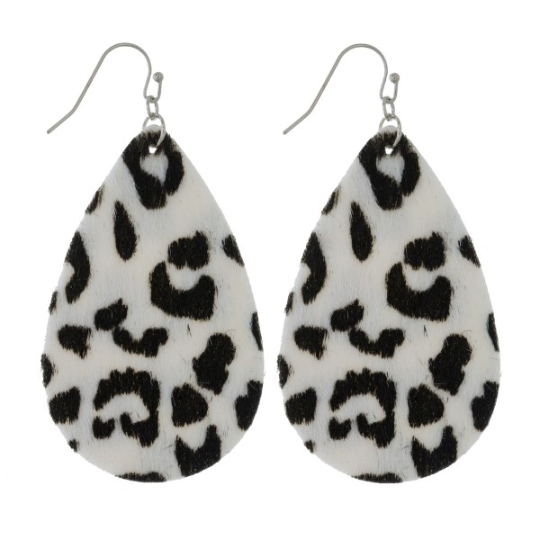 "Faux leather earrings with a teardrop shape and a faux fur animal print. Approximately 2.5"" in length."