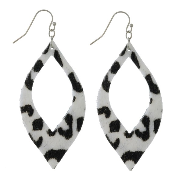 "Faux leather earrings with a cutout oval shape and an animal print. Approximately 2.5"" in length."