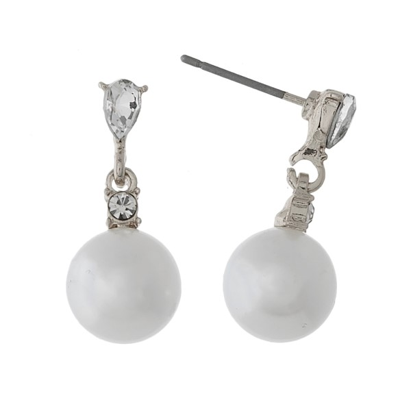 "Dainty pearl stud earrings with clear rhinestone accents. Approximately 1"" in length."