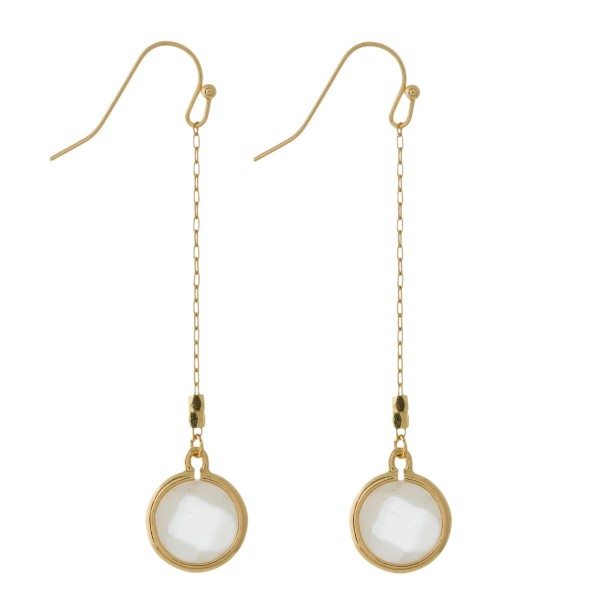 """Dainty gold tone fishhook earrings with a small, faceted stone. Approximately 2.5"""" in length."""