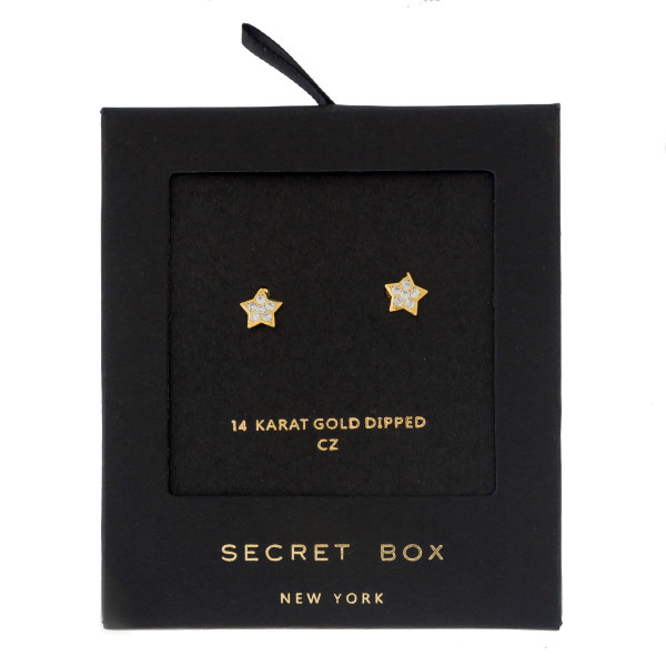 "Secret Box 14 karat gold dipped over brass star stud earrings. Approximately 1/4"" in length. Sold in a gift box."