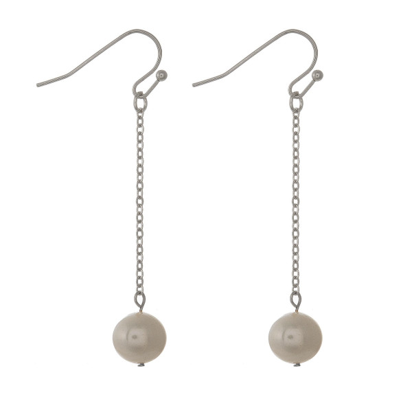 """Fishhook earring with drop pearl detail. Approximately 1.5"""" in length."""