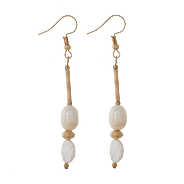 "Gold tone fishhook pearl earrings. Approximately 2"" in length."
