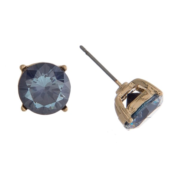 "Dainty, circle shaped, CZ stud earrings. Approximately 1/3"" in diameter."