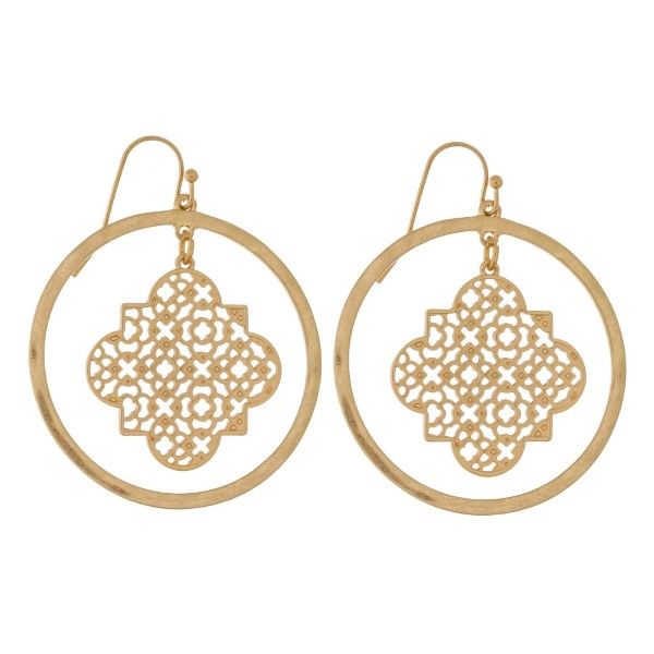 """Metal, fishhook earrings with a filigree quatrefoil shape and a hammered circle. Approximately 2"""" in length."""