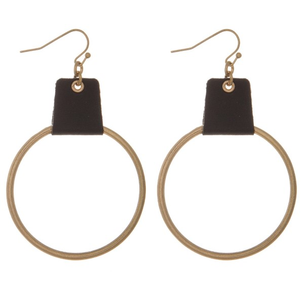"Metal, fishhook earring with circle shaped drop pendant accented with leather. Approximately 2"" in diameter."
