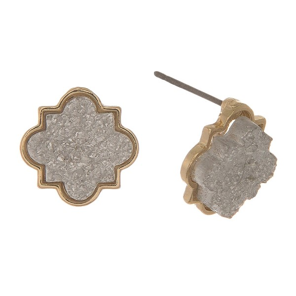 "Gold tone stud earrings with a quatrefoil shaped faux druzy stone. Approximately 1/2"" in diameter."