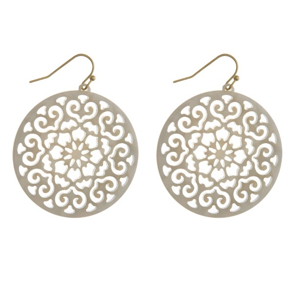 "Gold tone fishhook filigree acetate earring. Approximately 1.5"" in diameter."