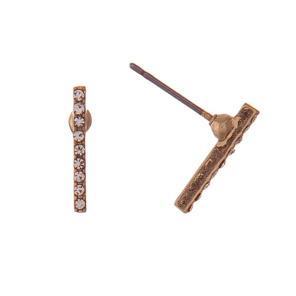 "Dainty bar earring with rhinestone detail. Approximately 1/2"" in length."