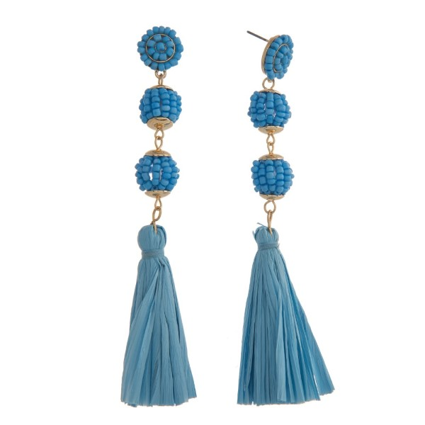 "Statement, post style earring with glass beads and raffia tassel detail. Approximately 4"" in length."