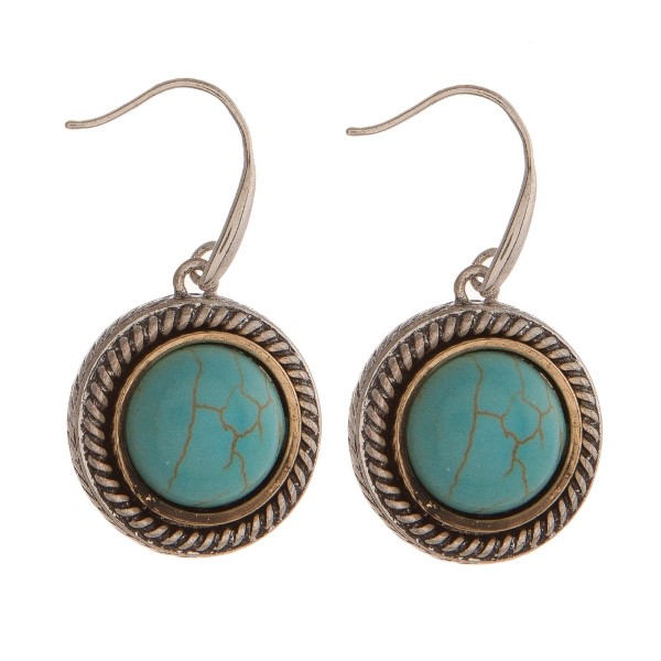 Silver tone earring with turquoise stone.