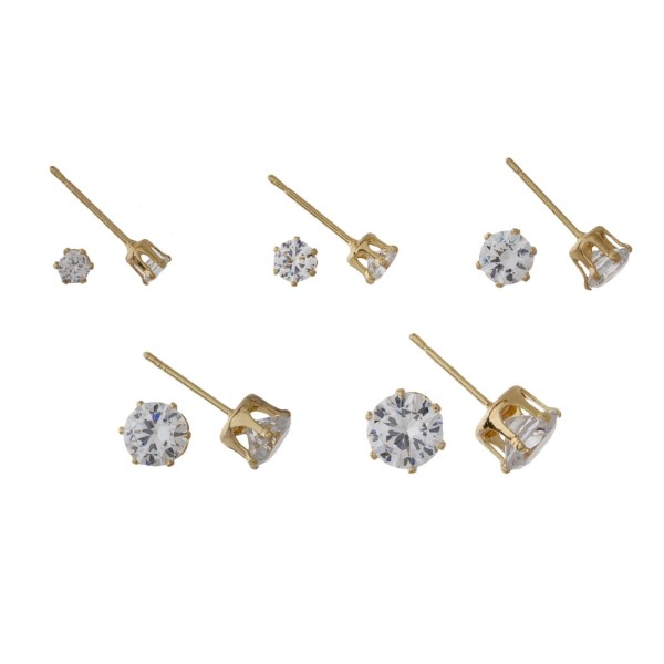 Five piece round CZ earrings.