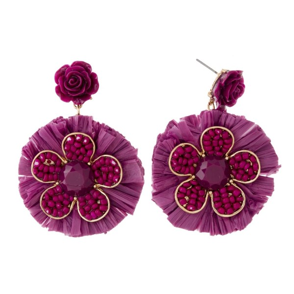 """Gold tone post earring with flower pendant and raffia fan. Approximately 2"""" in length."""