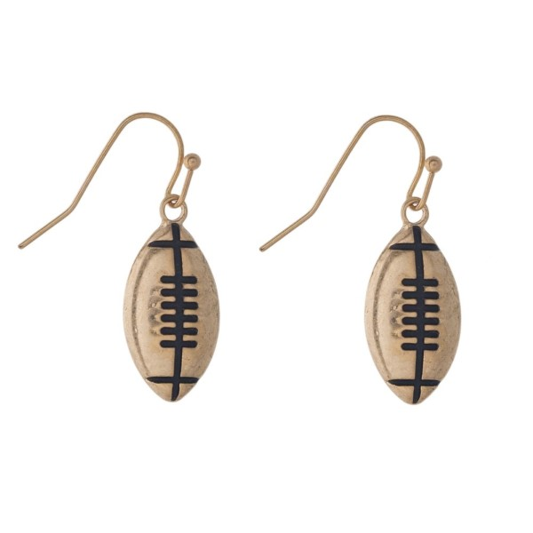 "Metal football earring. Approximately 1"" in length."