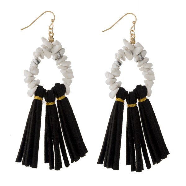 "Gold tone fishhook earring with natural stone beads and a faux leather fanned tassel. Approximately 2.5"" in length."