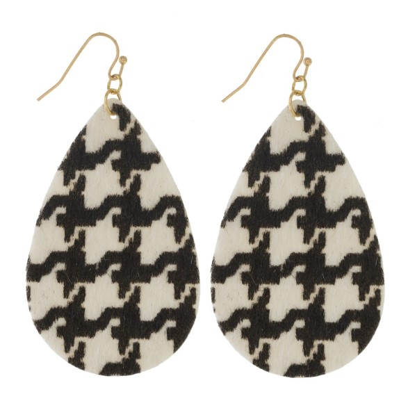 "Gold tone fishhook earring with houndstooth print. Approximately 2"" in length."