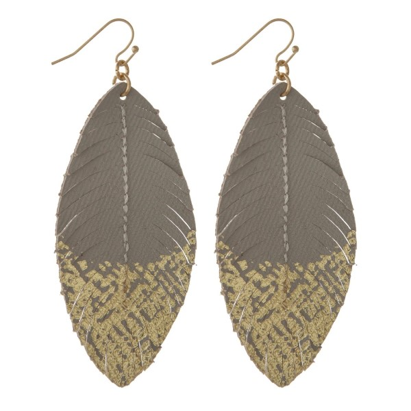 "Faux leather feather earring with gold accents. Approximately 2.5"" in length."