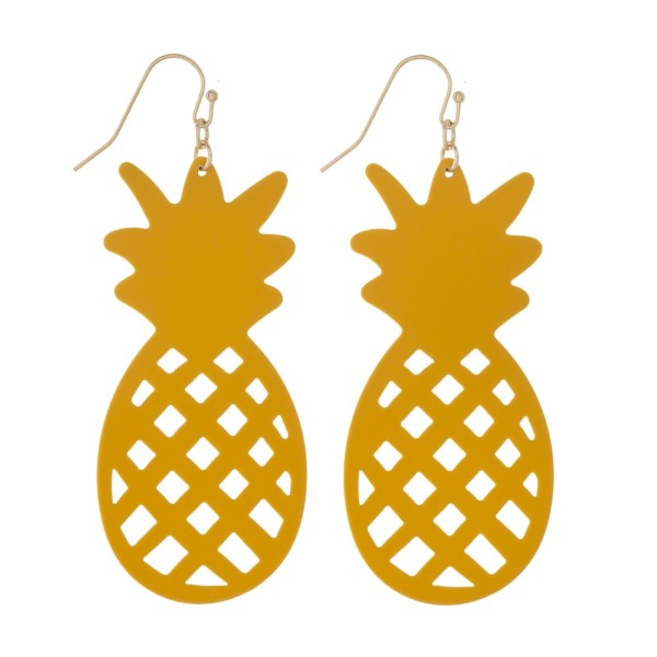 "Gold tone fishhook earring with metal pineapple design. Approximately 2"" in length."