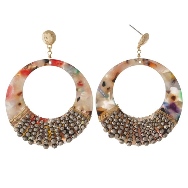 """Gold tone post statement earring with acetate circle design. Approximately 2"""" in length."""