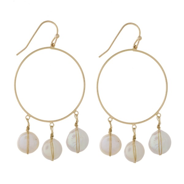 "Gold tone fishhook earring with pearl details. Approximately 1.75"" in length."