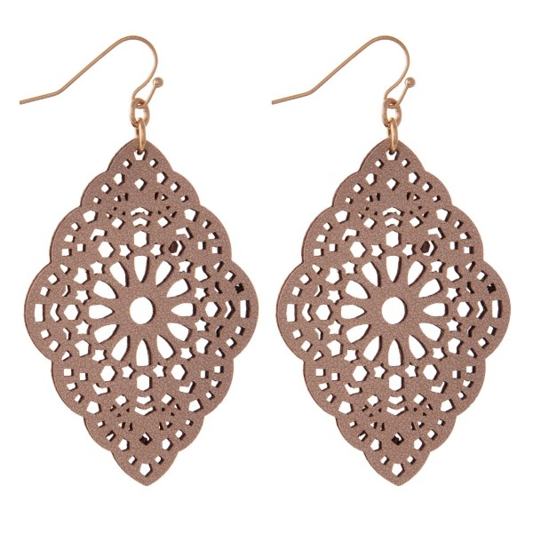 "Gold tone fishhook earring with filigree faux leather shape. Approximately 2"" in length."