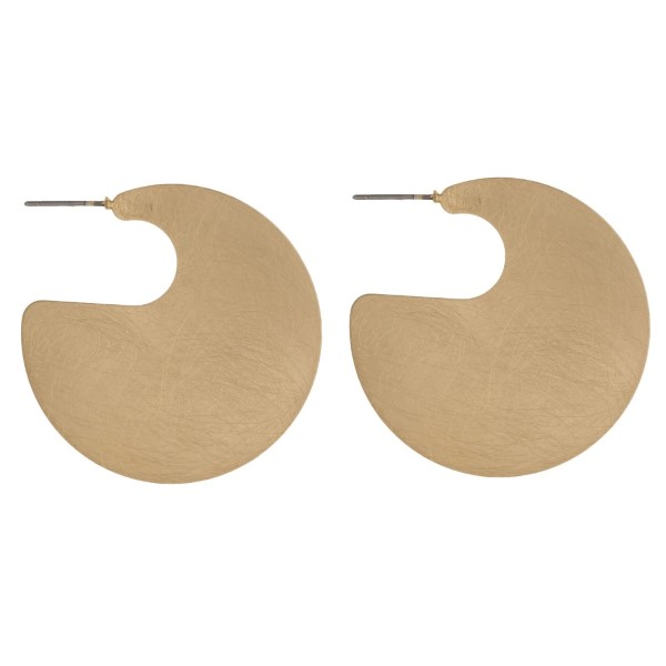 "Stud metal earring with circle shape. Approximately 1.25"" in length."