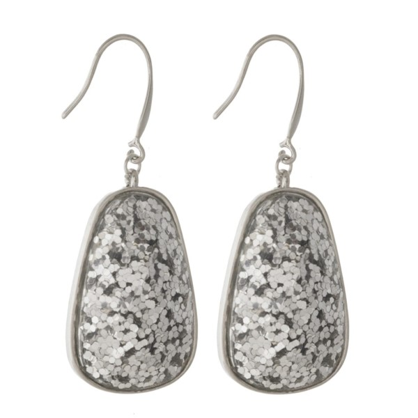 "Metal fishhook earring with glitter oval shape. Approximately 1.5"" in length."