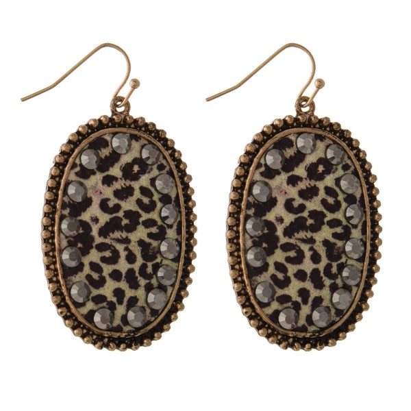 """Fishhook earring with oval shape accented with leopard print. Approximately 2"""" in length."""