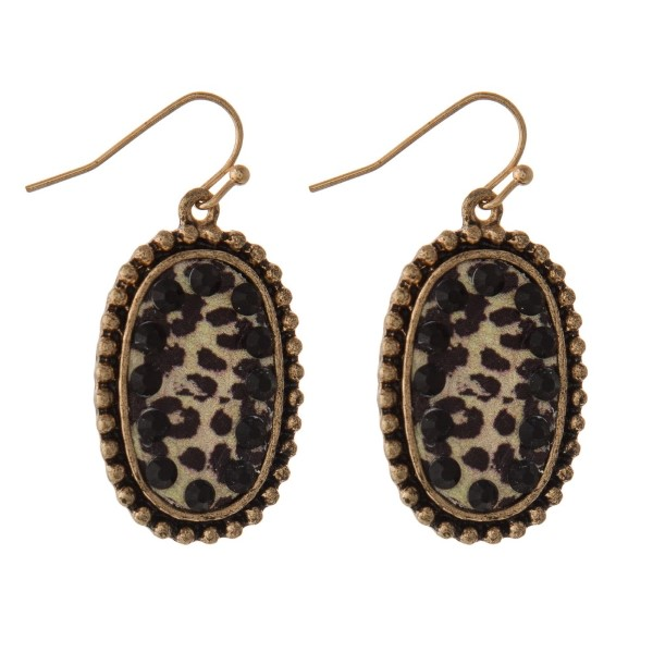 """Gold tone fishhook earring with leopard print oval shape. Approximately 1.5"""" in length."""