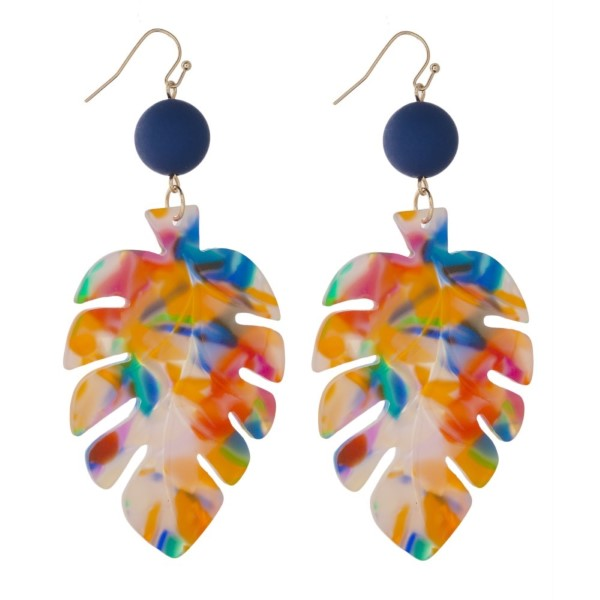 """Gold tone fishhook earring with acetate palm leaf shape. Approximately 3"""" in length."""