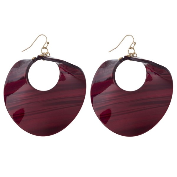 """Gold tone fishhook earring with twisted circle acetate shape. Approximately 2.5"""" in length."""