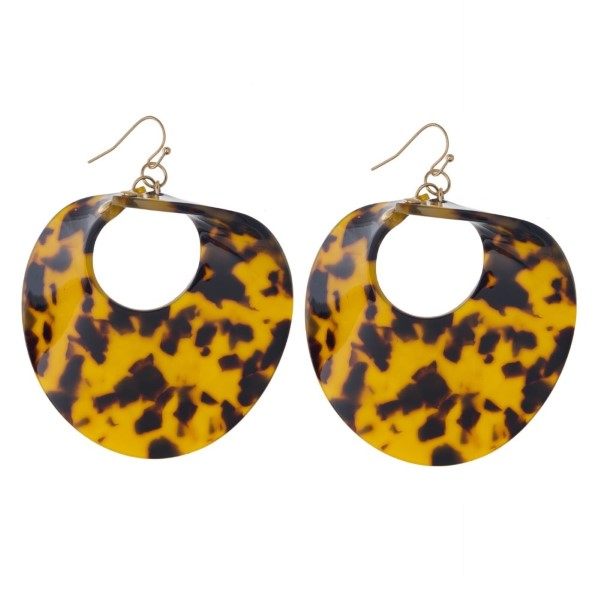 "Gold tone fishhook earring with twisted circle acetate shape. Approximately 2.5"" in length."
